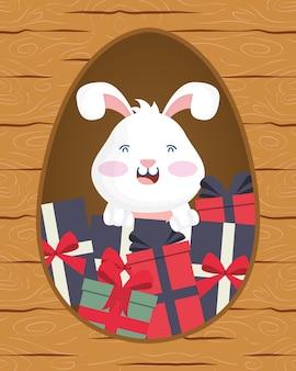Cartão de feliz páscoa com coelho e presentes em desenho de ilustração vetorial de cena de moldura de madeira