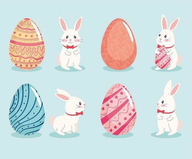 Cartão de feliz páscoa com conjunto de quatro ovos e ilustração de coelhos