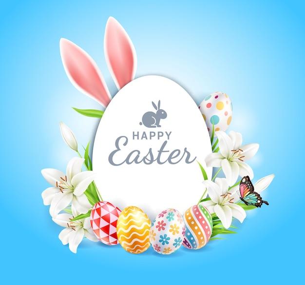 Cartão de feliz páscoa com orelhas de coelho, flores e borboletas sobre fundo de cor azul.