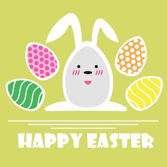 Cartão de feliz páscoa do vetor. ovos de páscoa e texto feliz páscoa em fundo verde