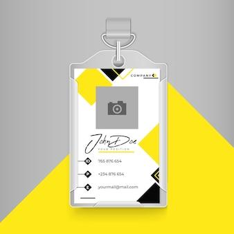 Cartão de identificação comercial em amarelo e preto com cores brancas