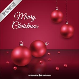Cartão de natal com bolas vermelhas