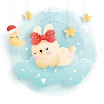 Cartão de natal com coelho bebê dormindo na nuvem, floresta. natal