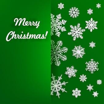 Cartão de natal com floco de neve recortado de papel em verde