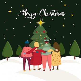 Cartão de natal com grupo de pessoas se abraçam em pé na frente da grande ilustração dos desenhos animados de árvore de natal