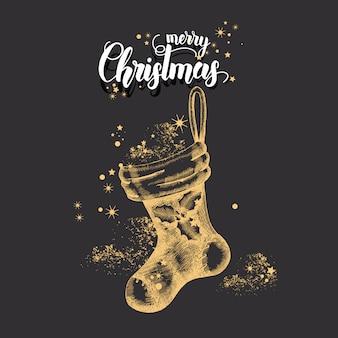 Cartão de natal com mão desenhada doodle meia de natal dourada e glitter. citação feita à mão
