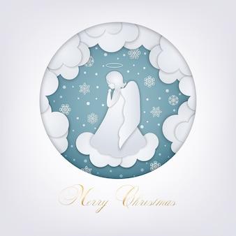 Cartão de natal com nuvens, flocos de neve e um pequeno anjo no estilo de papel em camadas. moldura azul redonda. um anjo bonito orando em um céu de neve de inverno. estilo de corte de papel cartão feliz natal.