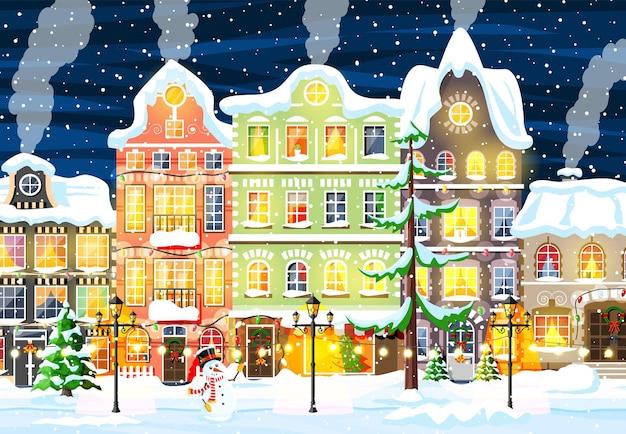 Cartão de natal com paisagem urbana e queda de neve.