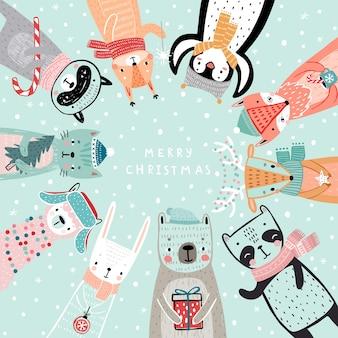 Cartão de natal com personagens desenhados à mão de animais estilo woodland