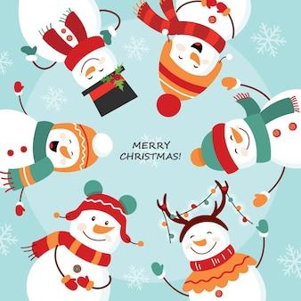 Cartão de natal. dança redonda dos bonecos de neve.