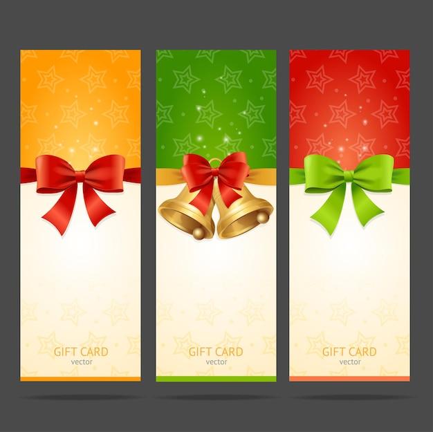 Cartão de natal de presente com conjunto de arco e sino.
