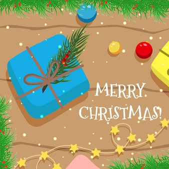 Cartão de natal de vetor com um presente, uma guirlanda e brinquedos para árvores de natal em uma mesa de madeira