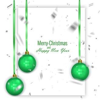 Cartão de natal e feliz ano novo decorado com bolas de natal de cor verde