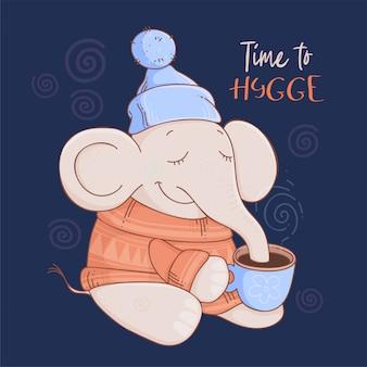 Cartão de natal elefante bonito dos desenhos animados em um suéter e chapéu com cacau
