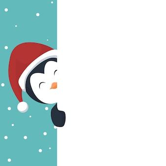 Cartão de natal pinguim saindo no cartaz branco para escrever