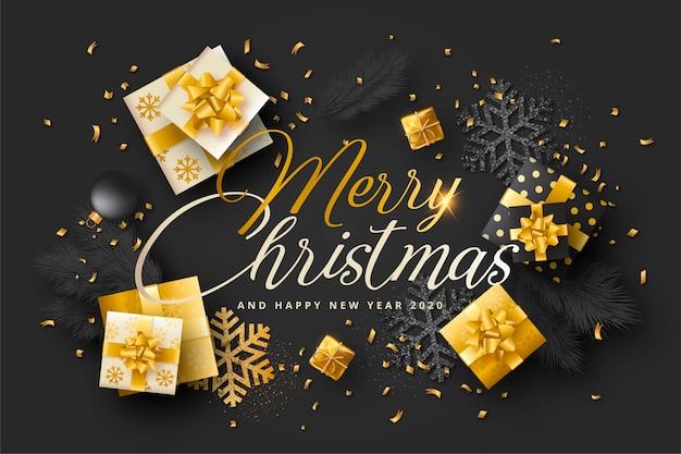 Cartão de natal realista com presentes pretos e dourados