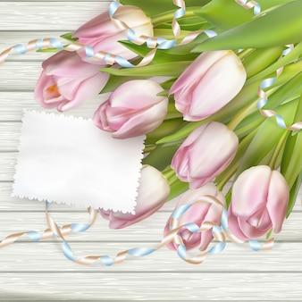 Cartão de papel com tulipas.