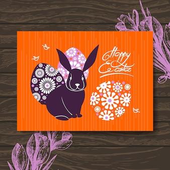 Cartão de páscoa. coelho e ovos da páscoa. fundo de madeira de ilustração desenhada à mão