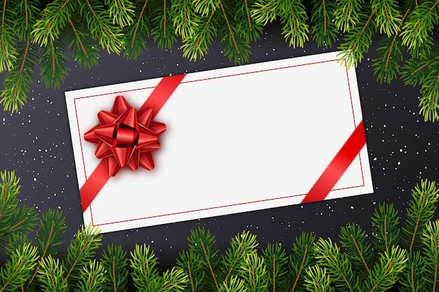 Cartão de presente de feriado com laço vermelho, galhos de árvore de abeto de natal