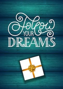 Cartão de presente de feriado com letras de mão siga seus sonhos