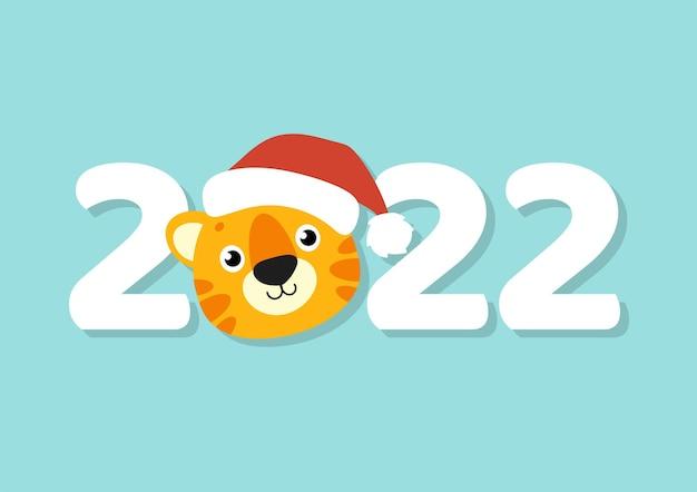 Cartão de saudação com a cor do presente símbolo do tigre em um chapéu de papai noel ano novo e feliz natal