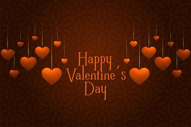 Cartão de saudação de comemoração de dia dos namorados com corações de suspensão