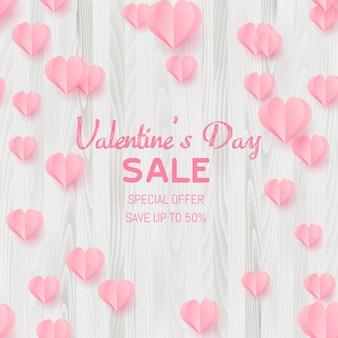 Cartão de venda de dia dos namorados com corações de corte de papel