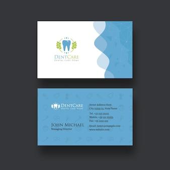 Cartão de visita azul para atendimento odontológico com desenho abstrato