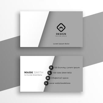 Cartão de visita branco e cinzento do estilo minimalista