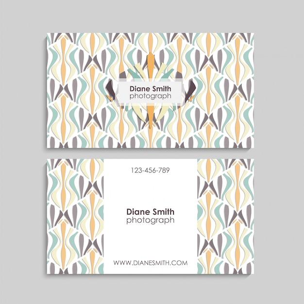 Cartão de visita com elementos abstratos.