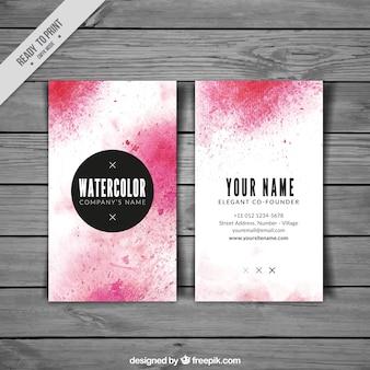 Cartão de visita com manchas cor de rosa da aguarela