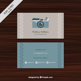 Cartão de visita com uma câmera do vintage ilustrado