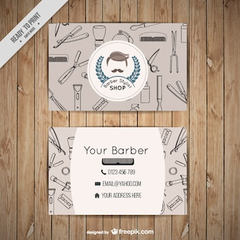 Cartão de visita da loja de barbeiro com ferramentas descritas