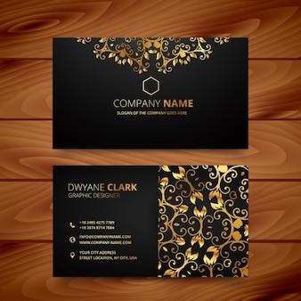 Cartão de visita de luxo com ornamentos de ouro