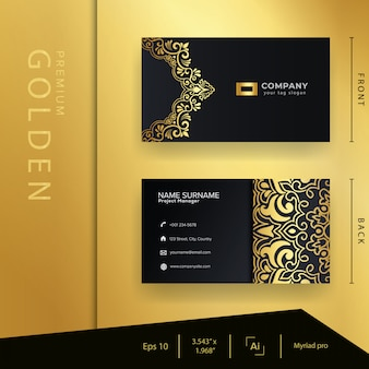 Cartão de visita dourado preto de luxo com ornamentos premium