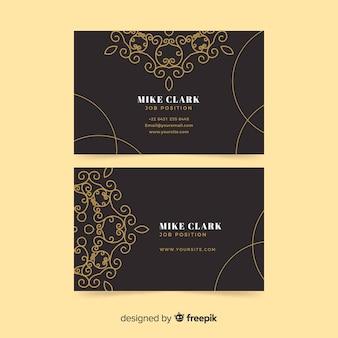 Cartão de visita elegante com ornamentos de ouro