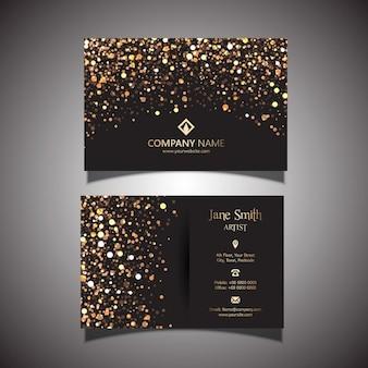 Cartão de visita elegante com um ouro e design preto