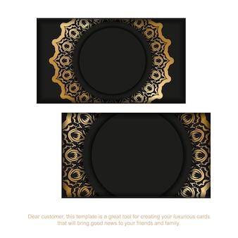 Cartão de visita preto com padrão dourado indiano