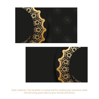 Cartão de visita preto com padrão grego dourado