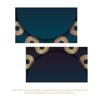 Cartão de visita verde gradiente com padrão de ouro indiano para seus contatos.