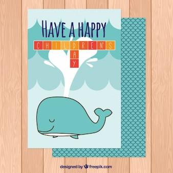 Cartão do dia das crianças grandes com uma baleia agradável