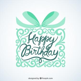 Cartão do feliz aniversario com presente ornamental