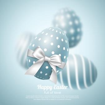 Cartão do feriado da páscoa. ovos realistas com arco branco, efeito de desfoque.