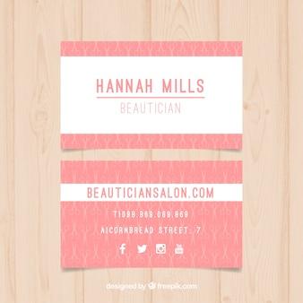 Cartão do salão de beleza rosa com pequenas tesouras