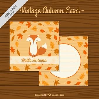 Cartão do vintage com bom raposa e folhas
