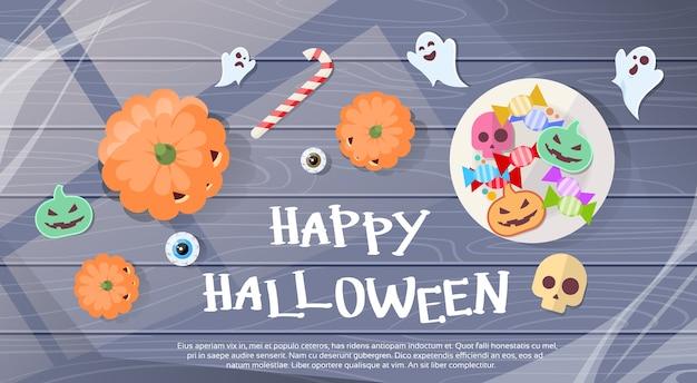 Cartão feliz da bandeira dos doces do dia das bruxas