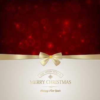 Cartão festivo de feliz natal com inscrição e laço de fita dourada em estrelas vermelhas brilhantes.