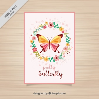 Cartão floral da borboleta com coroa de flores
