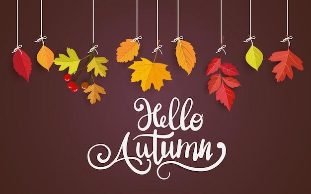 Cartão marrom com folhas de outono pendurado em um fio