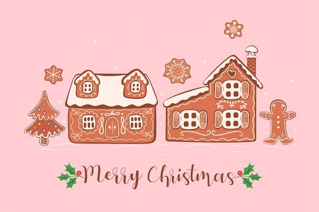 Cartão postal com biscoitos de gengibre e a inscrição feliz natal.